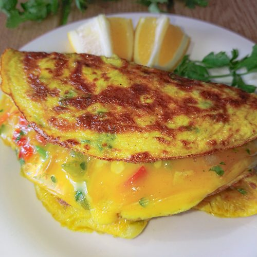 close-up view of omelet with vegetables and turmeric