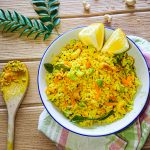 lemon rice recipe with brown rice, soy beans and carrots in a ceramic bowl