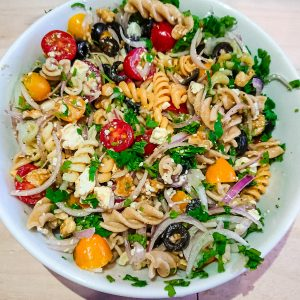 closeup view of veggie pasta salad with balsamic vinaigrette