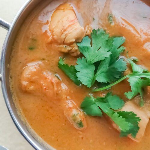 closeup view of 5 ingredient easy chicken curry in a stainless steel bowl
