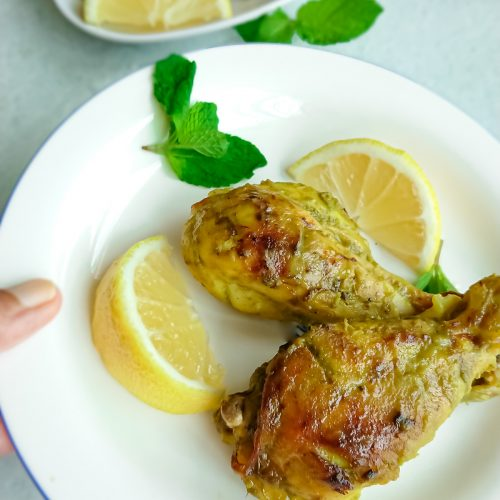 easy oven baked chicken legs in a white plate